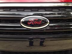 Black Emblem with Red Letters