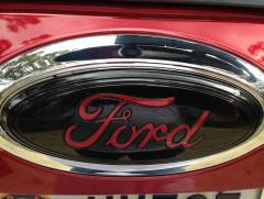 Black Emblems with Red Letters